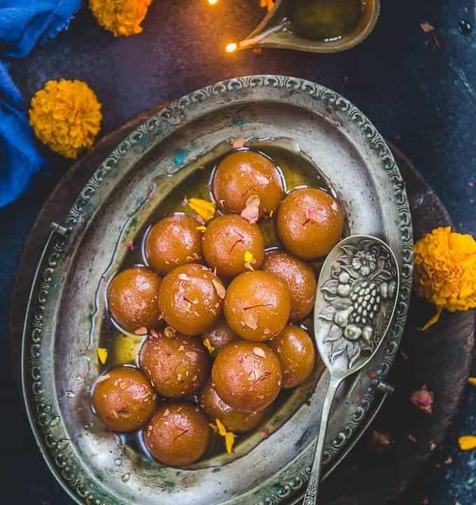 Gulab Jamun served in a plate.