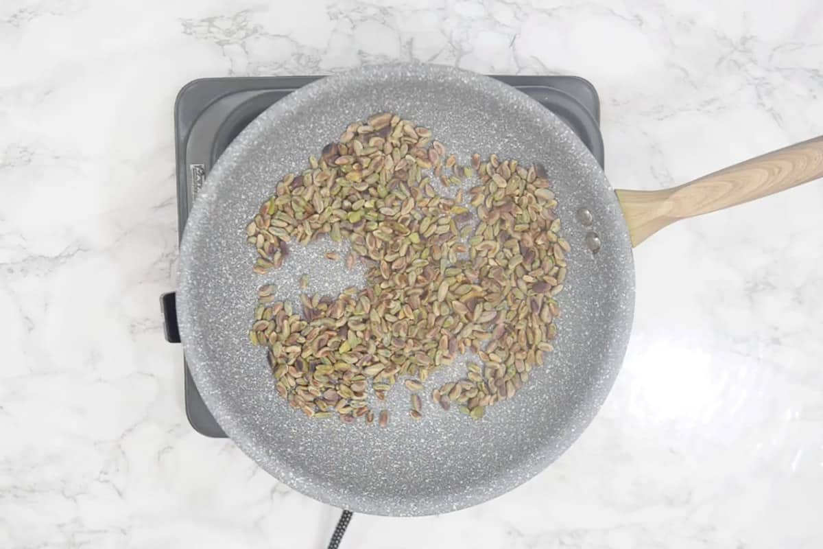 Pistachio roasting in a pan.