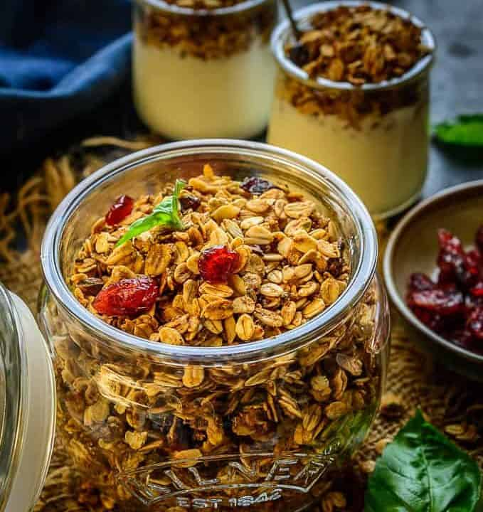 Gingerbread granola served in a jar.