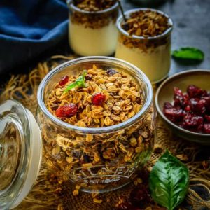 Gingerbread Granola is a Christmasy take on the regular granola with addition of Ginger Bread spices and Christmas colors from Pistachio and cranberries. Here is how to make Gingerbread Granola Recipe.