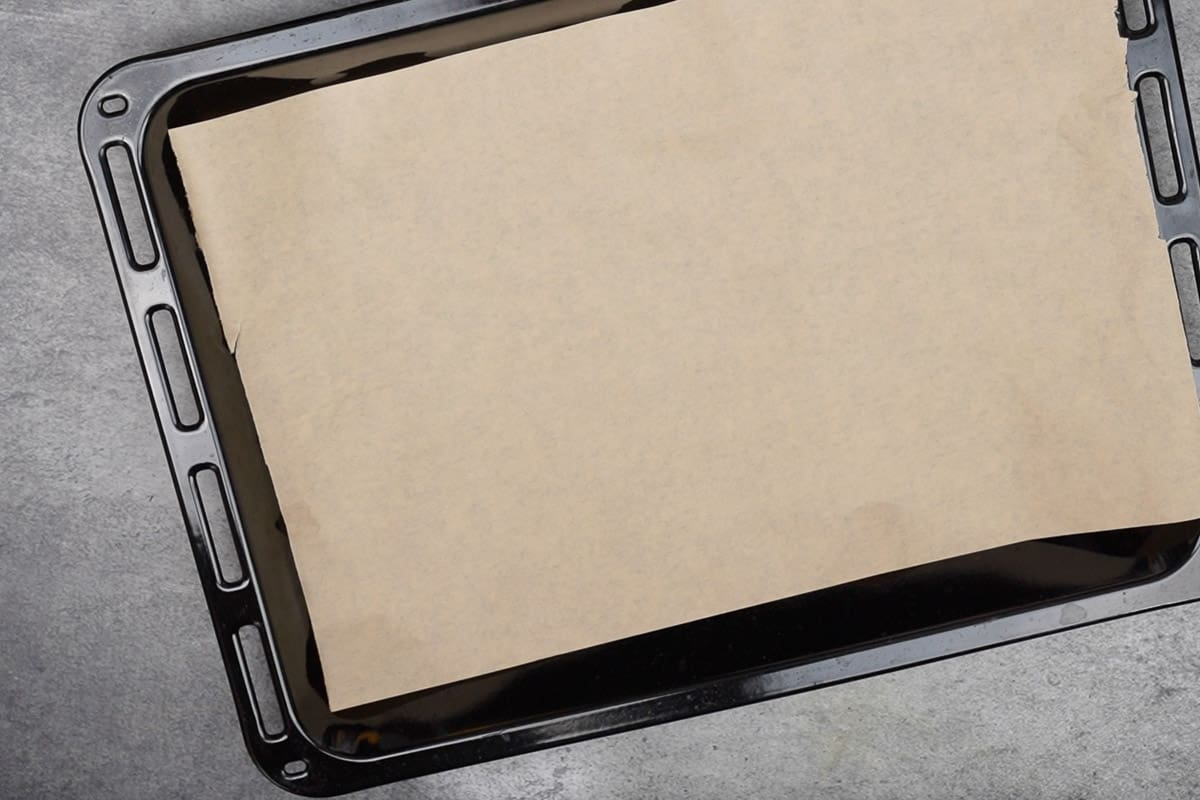 Baking tray lined with parchment paper.