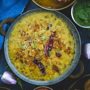 Panchmel Dal or Pancharatan Dal is a Rajasthani style lentil made my mixing 5 different types of lentils. This dal is served with Bati or roti.
