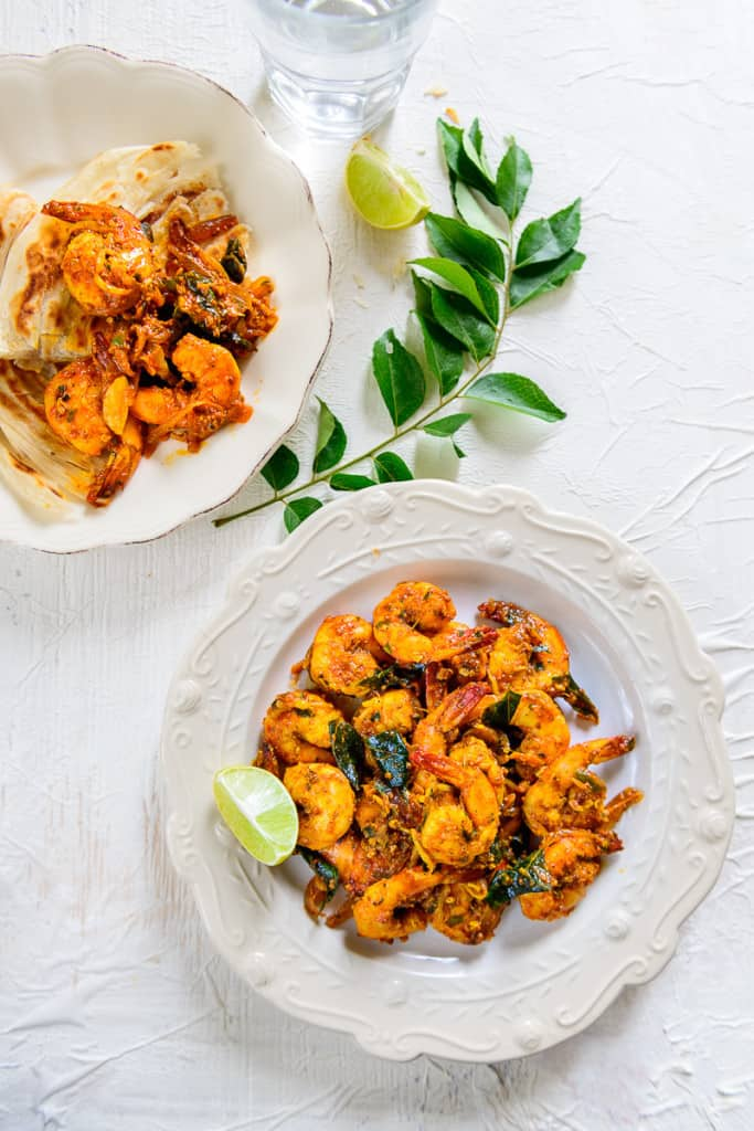 Kerala Style Prawn Roast is a traditional Kerala recipe which is at once tangy and spicy, with a beautiful blend of spices that infuses the prawn meat.