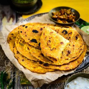 Lauki Thepla Recipe or Doodhi Thepla Recipe is a traditional Gujarati dish prepared using bottle gourd mixed with whole wheat flour.