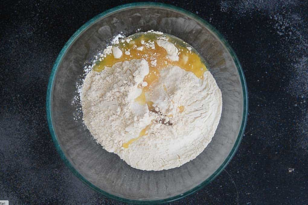 All purpose flour, whole wheat flour, salt and oil in a bowl.