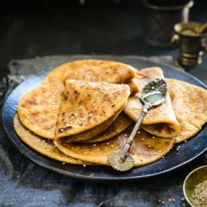 Til Gud Poli is a sweet chapatti/flatbread that is typically prepared during Makar Sankranthi. It is sweet, soft, delicious and best enjoyed with ghee.
