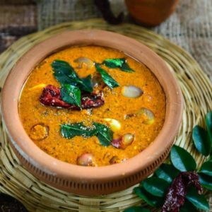 Ulli Theeyal Recipe is a quintessential Kerala gravy that is dark brown, loaded with flavor and best goes with white rice and ginger pickle.
