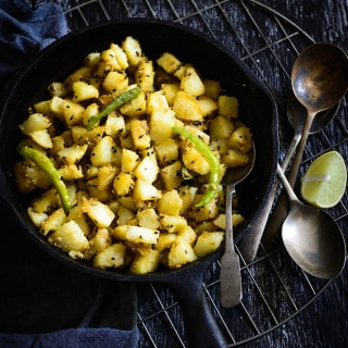 Aloo Posto is an authentic Bengali dish cooked where potatoes are cooked with poppy seeds. This popular dish of West Bengal is best enjoyed with steaming hot rice or roti along with a dal on the side.