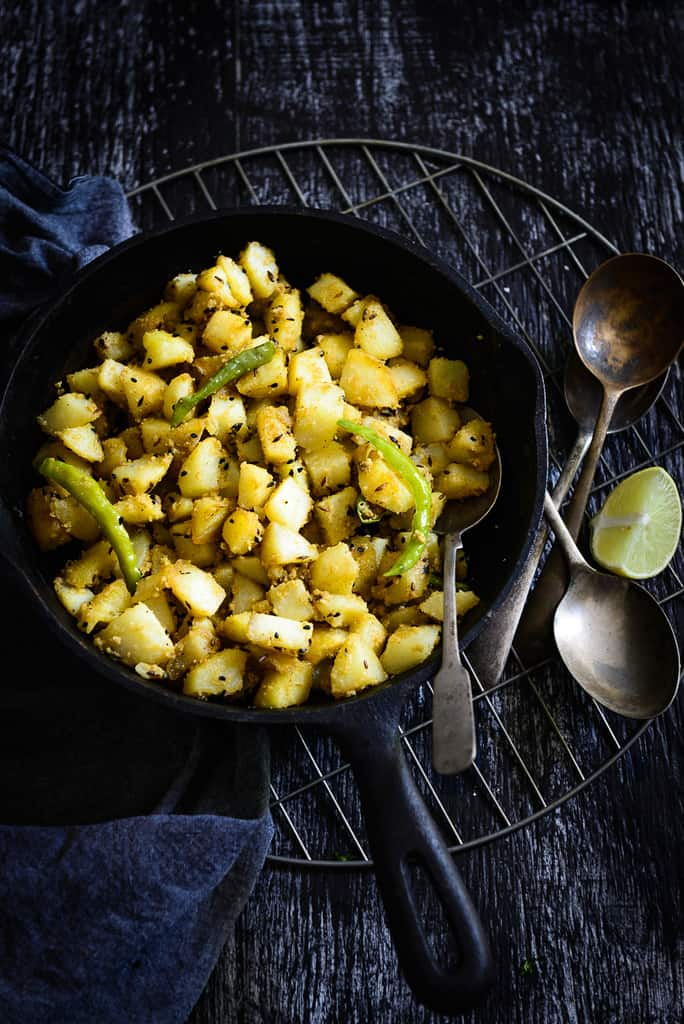 Poila Baisakh is the traditional New Year day of Bengali people and the festival is celebrated with processions, fairs, family time, and food! Aloo Posto is an authentic Bengali dish cooked where potatoes are cooked with poppy seeds. This popular dish of West Bengal is best enjoyed with steaming hot rice or roti along with a dal on the side.