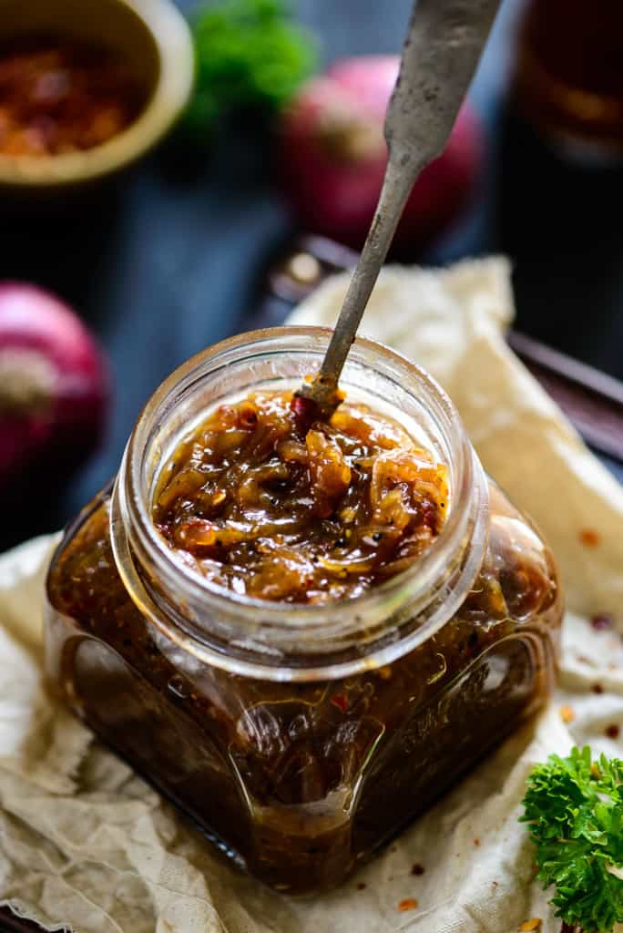 Soft, sticky and yet rich, caramelized Onion Marmalade makes for a wonderfully delicious topping for pizzas, bruschettas, sandwiches, burgers and basically any dish that requires a good base and great flavor.