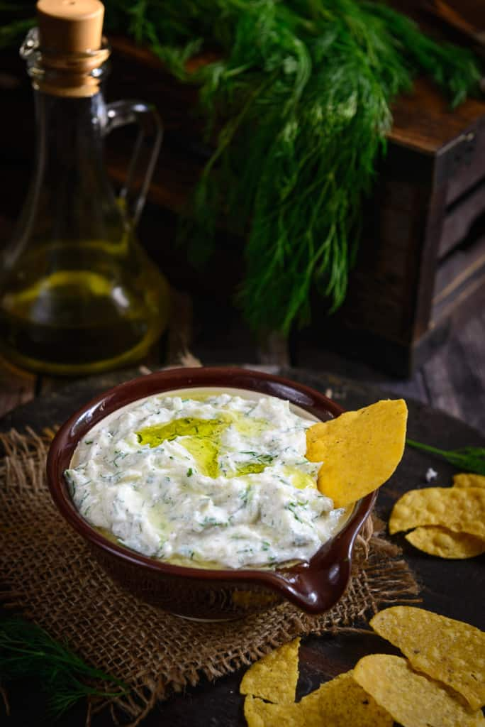 Tzatziki sauce is a Greek sauce and is usually served in Greek gyro sandwiches, but is also used in grilled meats or as a dip. Made of strained yogurt mixed with cucumbers and a multitude of spices, it has a salty, tangy and very garlicky taste