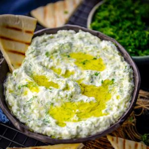 Creamy, rich, thick and white,Tzatziki Sauce is a traditional Greek dip which is made using thick and creamy yogurt, herbs and cucumber. Here is how to make easy homemade Tzatziki Recipe.