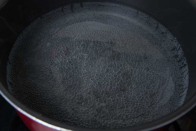 water boiling in a large pot