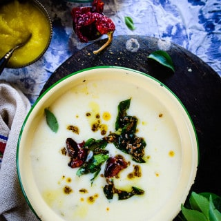 Gujarati Kadhi is a simple gravy made using chickpea flour and sour yogurt> it goes with with steamed rice or Gujarati Khichdi.