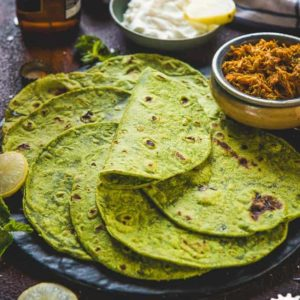 Spinach Tortilla is a delicious and healthy twist on the regular Tortilla recipe. It's super easy to make at home and I have a trick to make those round tortillas with zero effort. Check out the recipe.