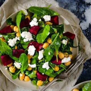 Fresh, vibrant and filling, Baby Spinach Chickpeas and Feta Salad is a versatile salad perfect for busy lunches and light dinners. Spinach, Chickpeas and Feta cover all the essential nutrient groups and have very subtle taste. Besides, olive oil and balsamic vinegar add a tanginess to it.