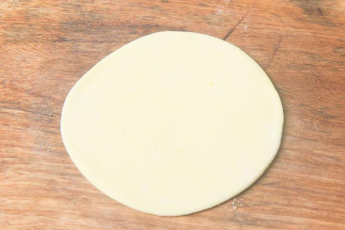 Dough rolled into a 4 inch circle