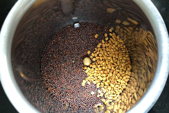 Mustard seeds and fenugreek seeds in a blender.