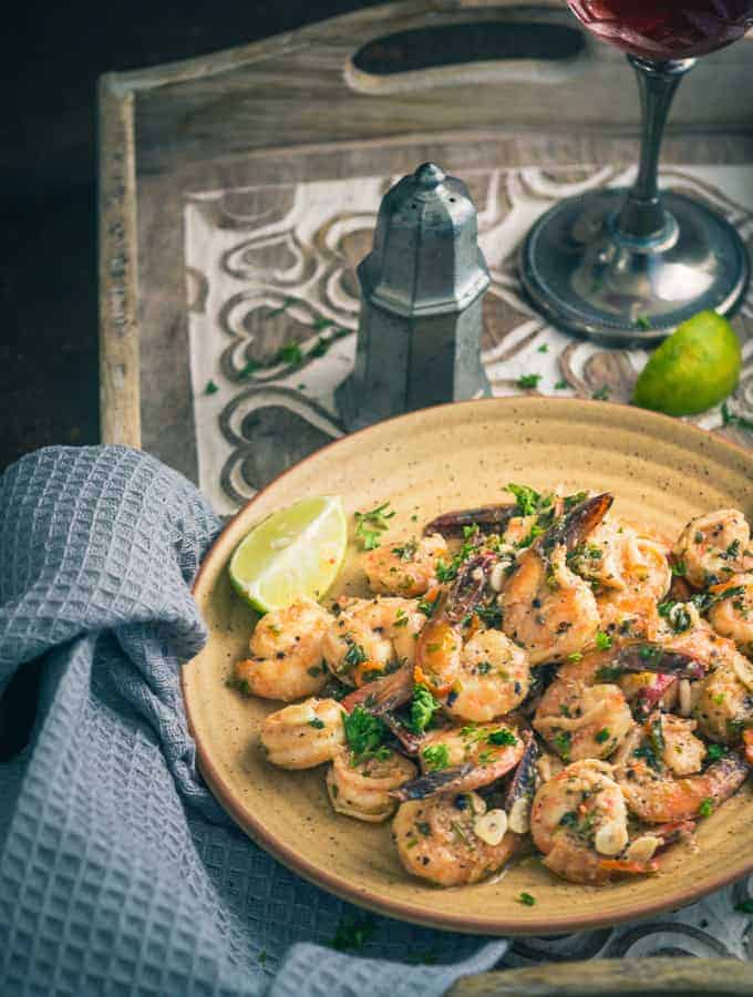 Garlic and Parsley Prawns are a protein-rich dish that tastes superb for lunch as well as dinner or can be served as an appetiser. Here is how to make it.