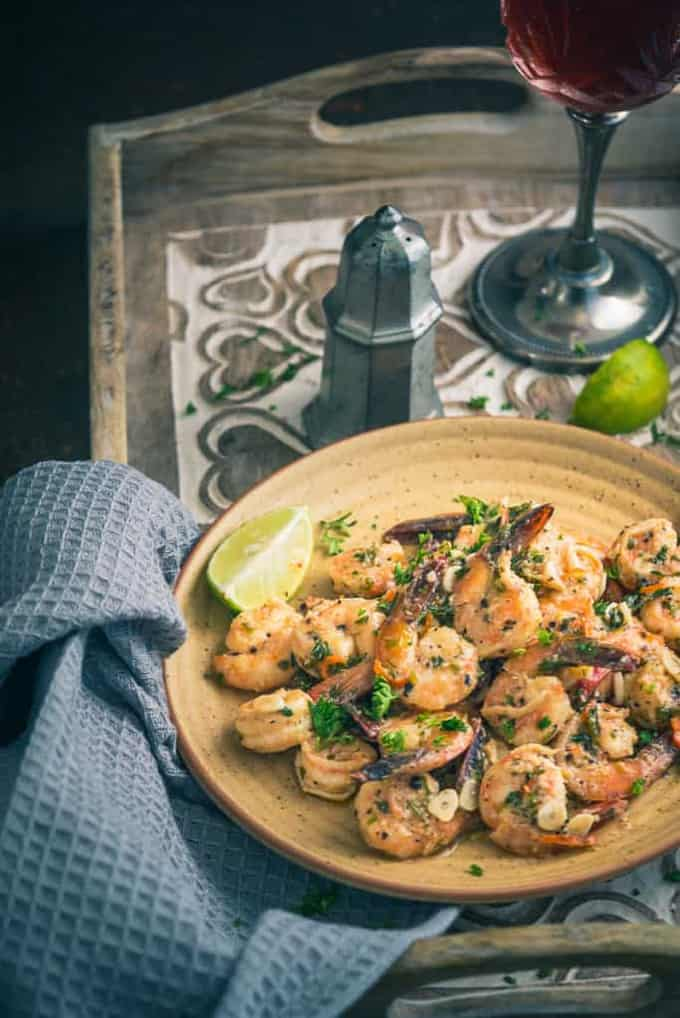 Garlic Parsley Prawns are a protein-rich dish that tastes superb for lunch as well as dinner or can be served as an appetiser. Here is how to make it.