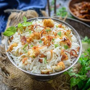 Nicely sauteed, Gobi Pulao or Cauliflower Pulao has this rich flavour of ghee, spices such as cloves and zeera. Serve it with raita for a healthy meal!