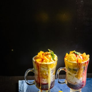 Mango Falooda is royal treat made from mangoes, milk and other ingredients. Relish it as a dessert or beverage whenever you like!