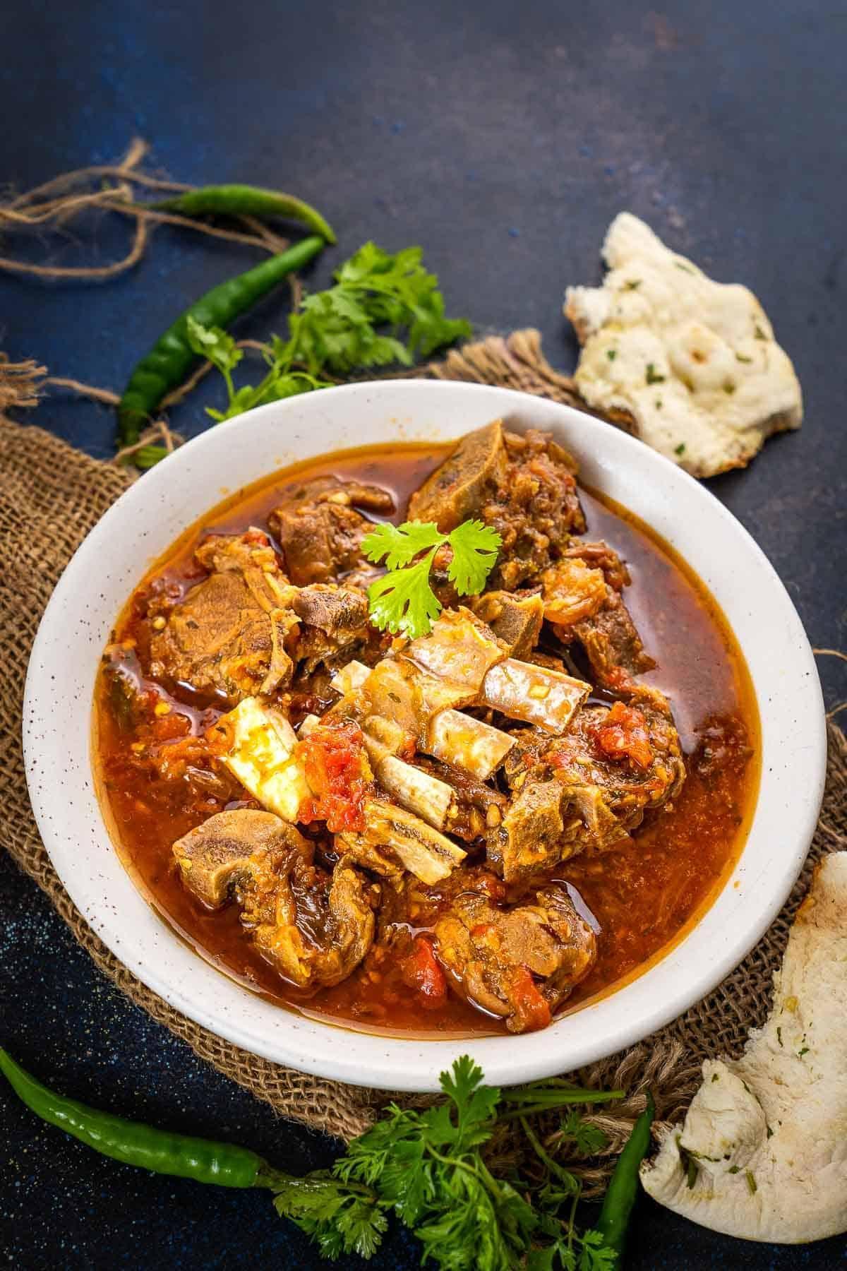 Peshawari Kadhai Gosht served in a bowl.
