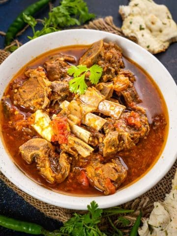 Peshawari Kadhai Gosht is a flavorful mutton curry made in the Peshawar region which is now a part of Pakistan. This mutton curry is made using very few ingredients in a kadai (heavy bottom pan). Here is how to make it.