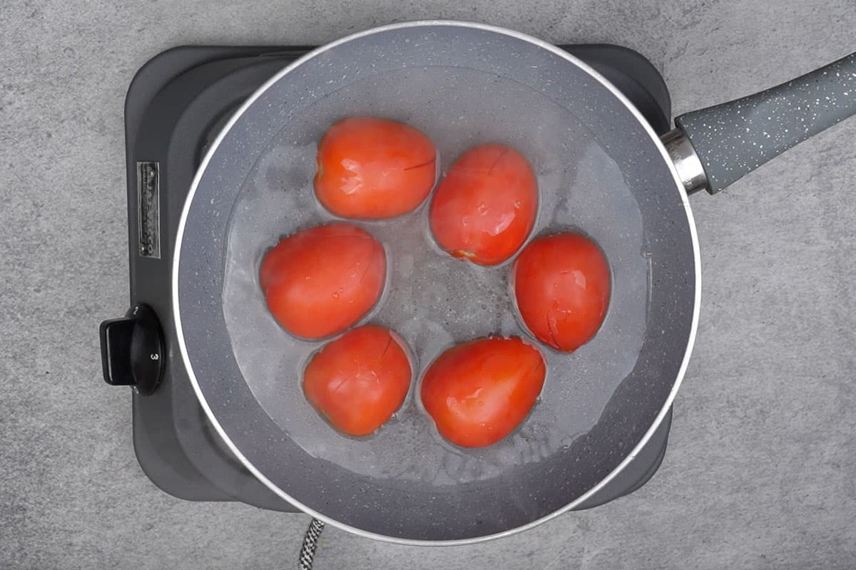 Tomatoes added to the pan.