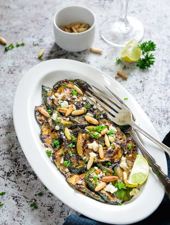 Balsamic Grilled Zucchini with Feta and Pine Nuts is a healthy accompaniment or snack that can be eaten round the clock. Do read its recipe!