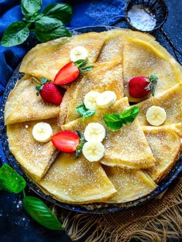 Crepes served on a plate.
