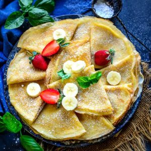 Crepes are a French style thin pancakes which are a popular breakfast option. They can be either sweet or savory. Here is how to make best homemade crepes recipe.