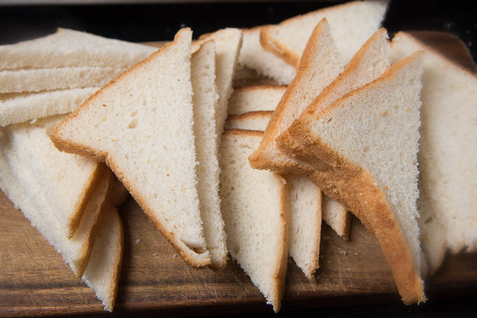 Bread slices cut into triangles.