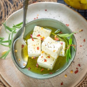 Marinated Feta Cheese, is a simple recipe where feta cheese is marinated with olive oil and herbs that has a beautiful texture and goes well with crackers and salads.