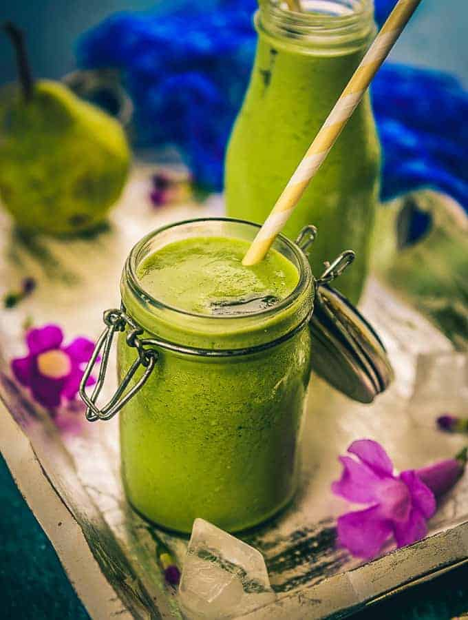 Pear Ginger Green Smoothie is a simple, delicious and healthy way to get in all your essential nutrients packed in a glass. Here is a step by Step recipe.