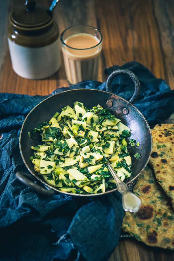 Aloo aur Hare Pyaz ki Bhujia is a quintessential Indian sabzi that you must savour at least once in life with piping hot Phulkas. Read its recipe: