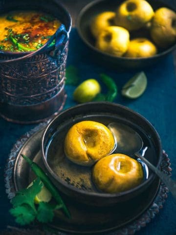 Bafla is a soothing variation of Baati. Baati is directly baked in the oven, whereas Bafla is first boiled and then baked. This process makes Bafla soft!