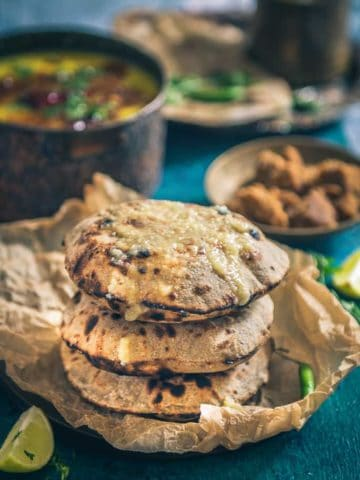 Bajre Ki Roti is a millet-based flatbread which can be served with both, vegetarian as well as non-vegetarian curries. Serve it piping hot with ghee.