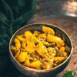 Hare Tamatar Ki Sabzi is a sweetish tangy accompaniment made from green tomatoes, jaggery and spices. You may serve it with Indian flatbreads or rice.