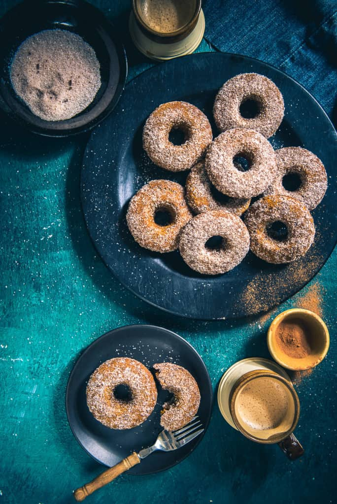 Fluffy, glazed with the charismatic flavours of pumpkin, Baked Pumpkin Spice Doughnut is an easy snack to be served to guests during parties or Halloween.