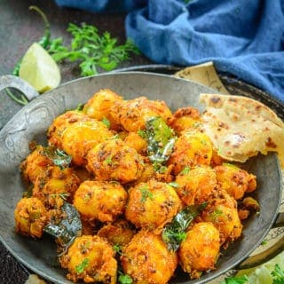 Bombay Potatoes served in a bowl.