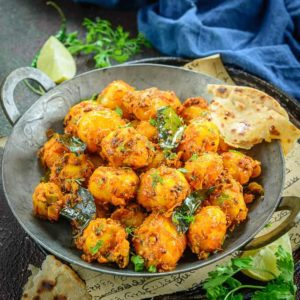 Bombay Potatoes is a popular dish made using baby potatoes and Indian masalas. Popular in the UK as well, this easy and simple to make tasty potato dish can be served with Rotis, Dal and Rice. Here is how to make Homemade Bombay Potato Curry.