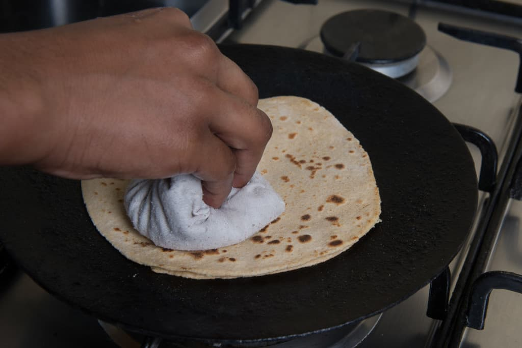 Dupalli Roti means a two layered roti, which is made by jointly rolling two equal sized whole wheat dough balls separated by a layer of ghee.