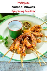 Grilled Sambal Prawns are pungent munchies made using prawns marinated with sambal paste which are grilled using skewers. Serve them for supper or as sides. Here is a video recipe to make Sambal Prawns. #Malaysian #Prawns #Shrimps #Seafood #healthy #Grilling #Recipe