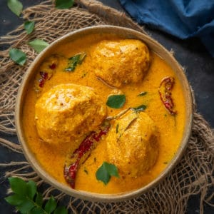 Mambazha Pulissery or Kerala Style Ripe Mango Curry is a delicious sweet and spicy preparation that goes perfectly well with Steamed Rice.