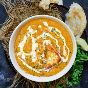 Paneer Pasanda are paneer triangles stuffed with rich khoya mixture and then shallow fried in a thick, creamy, tomato based gravy. Here is an easy restaurant style recipe to make Paneer Pasanda at home.
