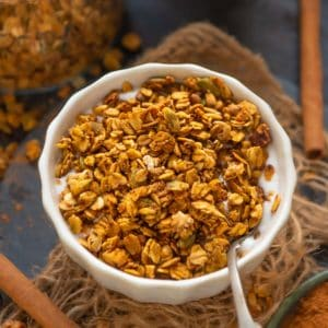 Make this healthy and super easy homemade Pumpkin Spice Granola at home in under 30 minutes and using 8 ingredients. It's super crunchy and loaded with fall flavors.