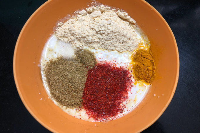 Spices mixed in curd.