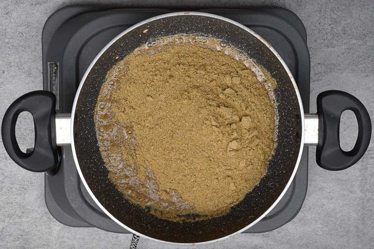Coriander powder added to the pan.