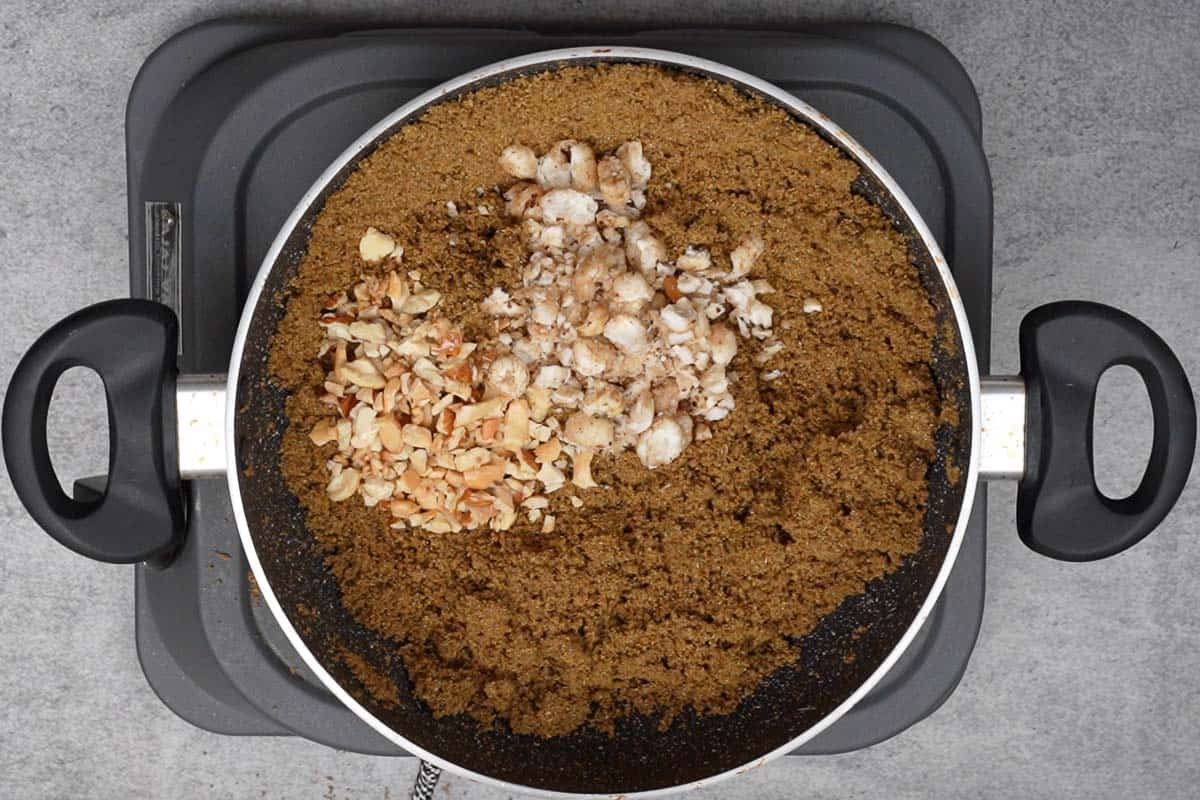 Roasted nuts added to the pan.
